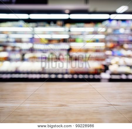 Table Top Counter Bar With Blurred Supermarket products Shelf Background