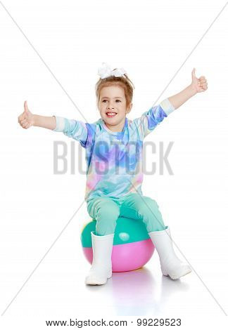 Girl sitting on the ball