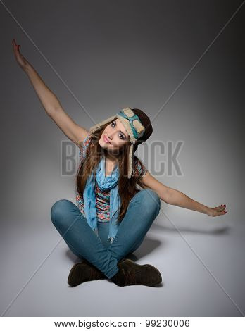 portrait of beautiful young woman aviator flying indoor