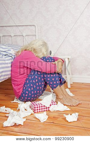 Sad Woman Sitting On Floor Against Bed