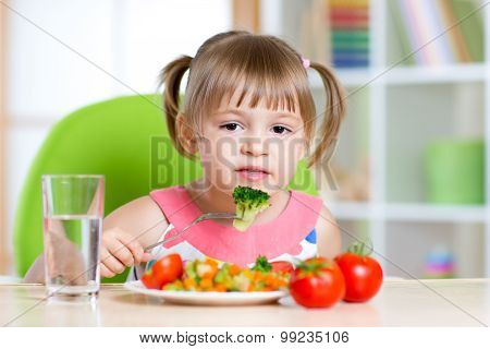 kid eating healthy food in kindergarten or at home