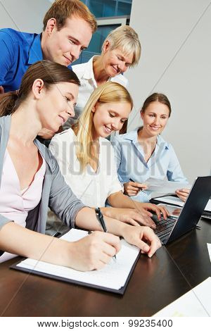 Business team using internet connection with laptop computer in the office