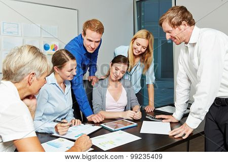 Young business people working together as a team in the office with tablet computer
