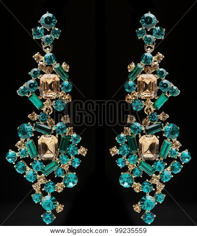 earrings with green stones on the black