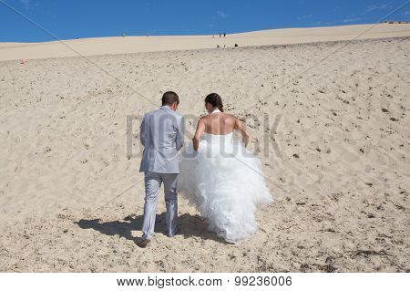 Happy Bride And Groom On A Beautiful Beach