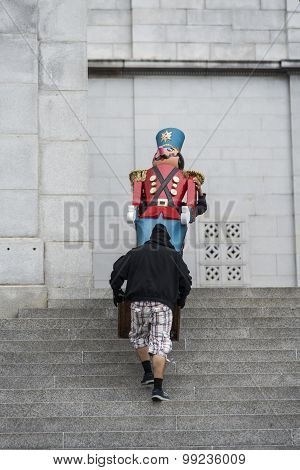 Stagehand carry a statue of nutcracker solider in city Los Angeles city hall