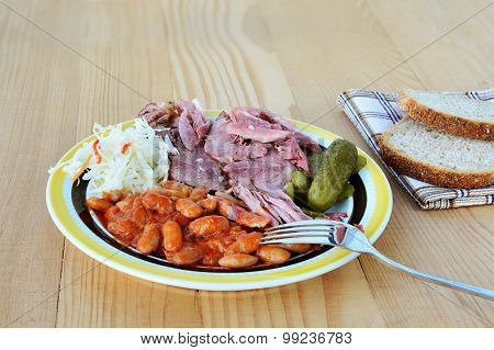 Beans Stew In Tomato Sauce With Smoked Pork Meat Pickles And Coleslaw