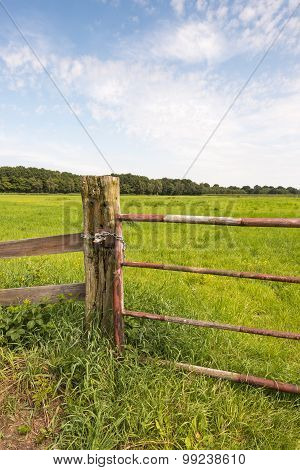 Rusty Gate In A Rural Landscape From Close