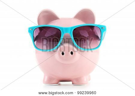 Pink Piggy Bank With Glasses Isolated On A White