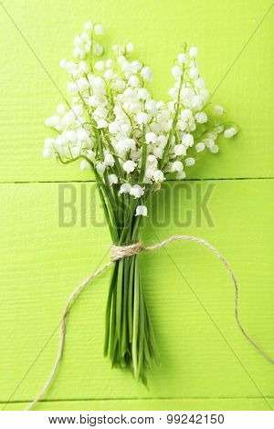 Lily Of The Valley On Green Wooden Background