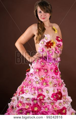 gorgeous woman in a dress from flowers