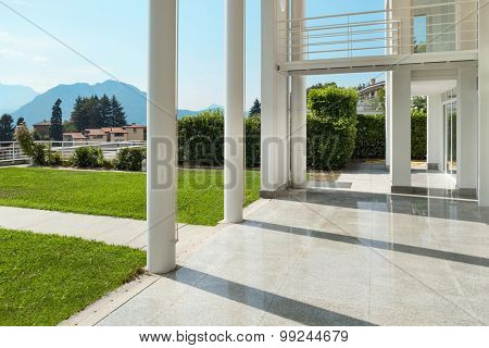 Architecture, wide veranda of a modern house, exterior
