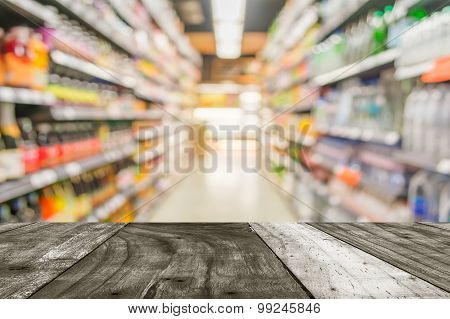 Blurred Image Of Shopping Mall And People For Background Usage.