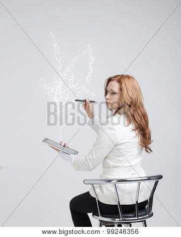 young woman drawing a plant