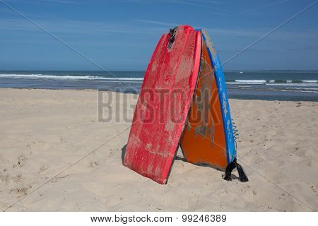 Bodyboard On The Sand At Summertime