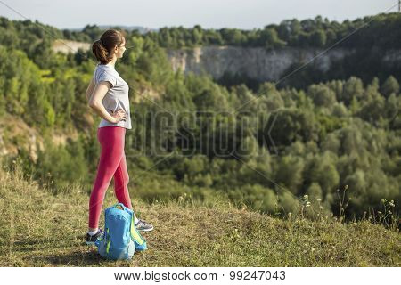 Young sport woman traveler on the top of mountain.