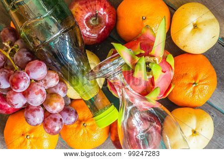 Background Of Fruit And A Bottle Of Juice.