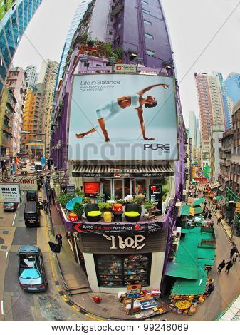 HONG KONG - DECEMBER 11, 2014: Hong Kong Special Administrative Region. Shopping street in Hong Kong. The building's facade is decorated with advertising yoga