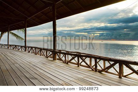 Wood Terrace In Wooden Pavillion Against Peaceful Of Heaven Sea Beach