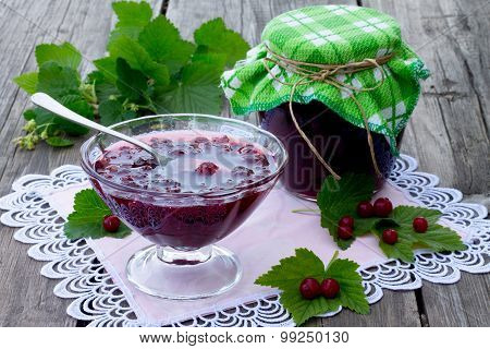 Red Currant Jam On A Wooden Background