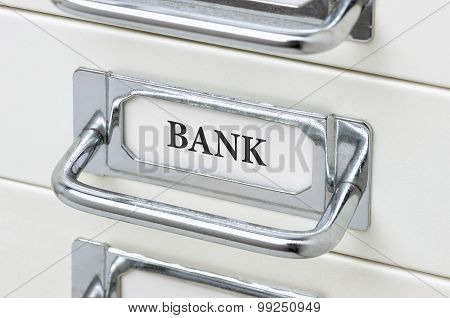 A Drawer Cabinet With The Label Bank