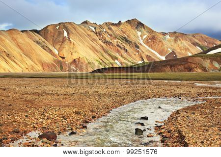 The route starts on a stream. Gorgeous orange and pink mountains. Reserve Landmannalaugar, Iceland