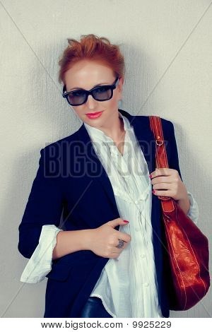 Woman In Black Jacket With Leather Bag.