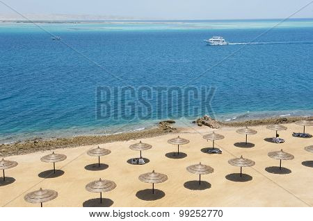 Tropical Beach With Parasols