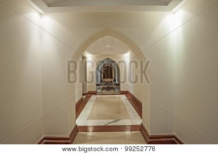 Interior Corridor Of Large Villa With Arches
