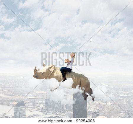Young pretty fearless woman riding huge flying