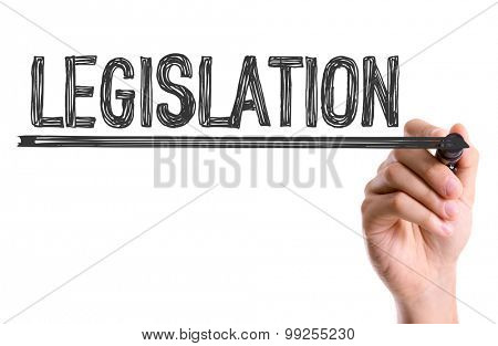 Hand with marker writing the word Legislation