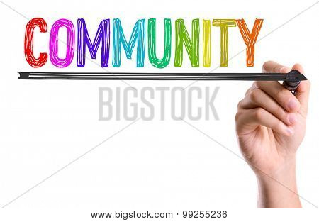 Hand with marker writing the word Community