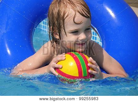 Child in swimming pool. Little girl playing in water. Vacation and traveling with kids. Children play outdoors in summer