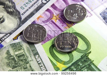 Coin one ruble and the European and USA currency