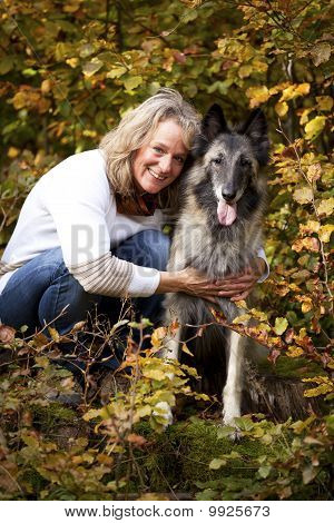 blond woman with Belgian shepherd