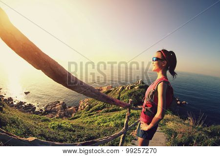 young fitness woman trail runner enjoy the view on seaside mountain trail