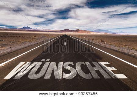 Wishes (in German) written on desert road