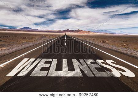 Wellness written on desert road