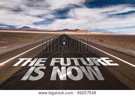 The Future is Now written on desert road
