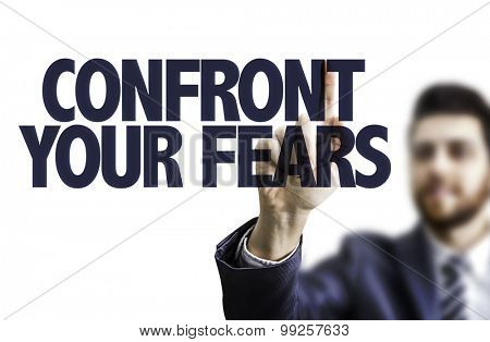 Business man pointing the text: Confront Your Fears