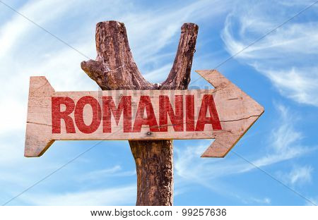 Romania wooden sign with sky background