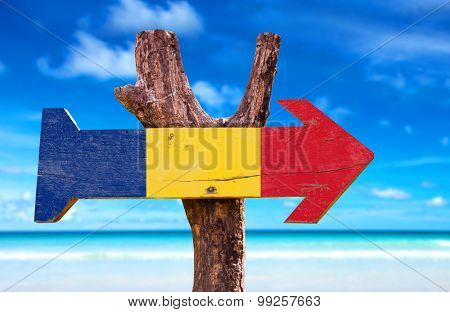Romania Flag wooden sign with beach background