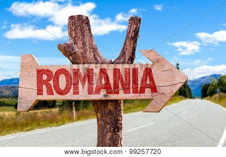 Romania wooden sign with road background