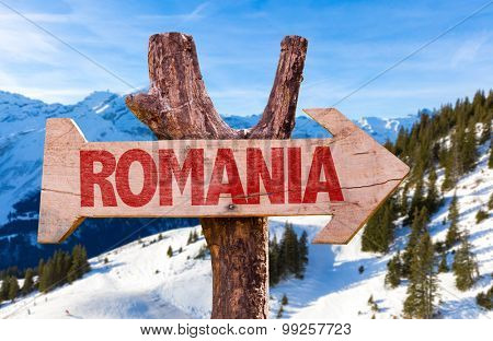 Romania wooden sign with winter background