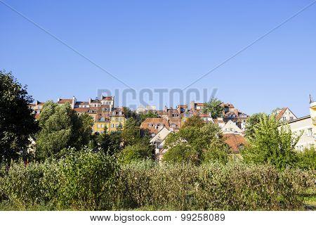 Townhouses Rises Over The Green Vegetation