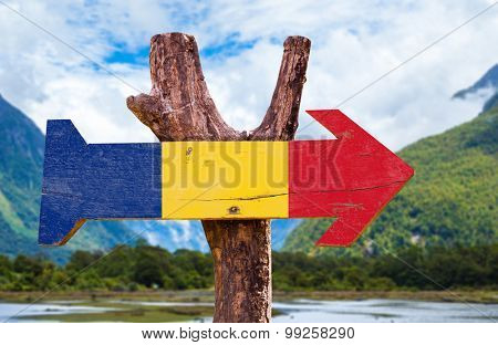 Romania Flag wooden sign with mountains background