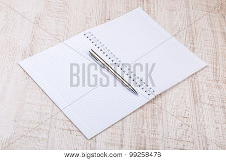 blank white notebook on the desk.