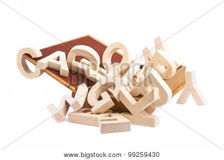 Multiple wooden letters in a book