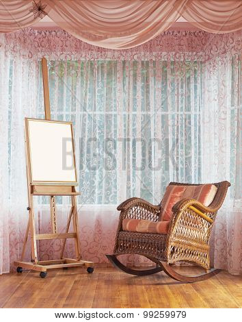 Wooden easel and wicker rocking chair composition