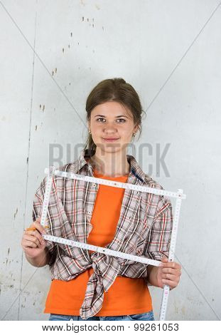 Young Female Worker With Ruler